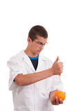 Toxin injection in orange with syringe Royalty Free Stock Photos