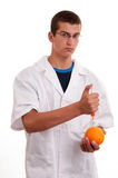 Toxin injection in orange with syringe Stock Photo