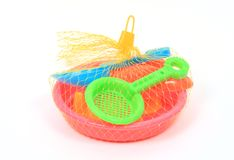 Toy. S packed in nylon net on white stock photo