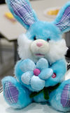 Toy 4. Blue bunny with flower toy stock images