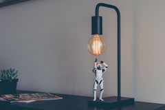 Toy action figure and light bulb Stock Photos