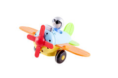 Toy airplane. With a pilot on a white background Stock Image