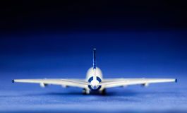 Toy airplane on blue background Stock Photo