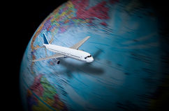 Toy airplane flying around the globe Royalty Free Stock Image