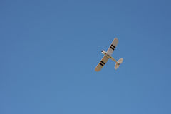Toy airplane flying. In the sky Royalty Free Stock Image