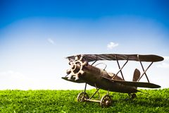 Toy Airplane on grass on a sunny day Royalty Free Stock Photography