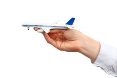 Toy airplane in hand. Stock Photos