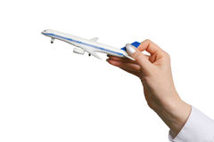 Toy airplane in hand. Stock Images