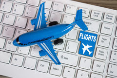 Toy airplane on keyboard online booking or purchase of plane tic. Toy airplane and plane sign on keyboard, to illustrate online booking or purchase of plane Stock Photos