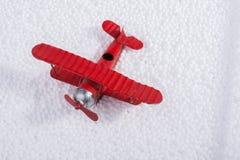 Toy airplane on little  white polystyrene balls Royalty Free Stock Photo