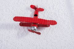 Toy airplane on little  white polystyrene balls Stock Images