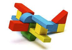 Toy airplane, multicolor wooden blocks air plane transport. Isolated white background Royalty Free Stock Images