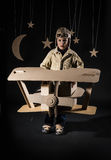 Toy airplane at night. Boy is playing with handmade toy plane. Decorations of night sky is on background Stock Photography