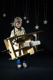 Toy airplane at night. Boy is playing with handmade toy plane. Decorations of night sky is on background Royalty Free Stock Photography