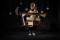Toy airplane at night. Boy is playing with handmade toy plane. Decorations of night sky is on background Stock Photos