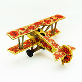 Toy airplane painted in khokhloma style on white background. Toy airplane painted in khokhloma style isolated on white background royalty free stock photo