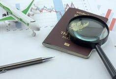 Toy airplane and passport Stock Photo