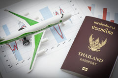 Toy airplane and passport Stock Images