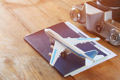 Toy airplane and passport over wooden table royalty free stock photography