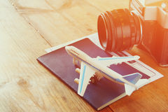 Toy airplane and passport over wooden table. retro style image.  royalty free stock image