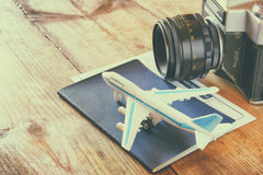 Toy airplane and passport over wooden table. retro style image.  stock images