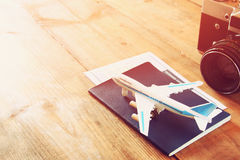 Toy airplane and passport over wooden table. retro style image.  royalty free stock photos