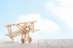 Toy airplane on wood. And sky background (retro filter Royalty Free Stock Photography