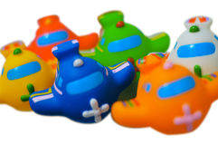 Toy Airplanes. A row of six toy airplanes. Isolated with white background. Contains work paths Royalty Free Stock Photo