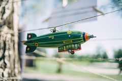 A toy airship hangs on a string stock images