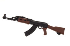 Toy Ak-47 machine gun. Isolated over white Stock Image