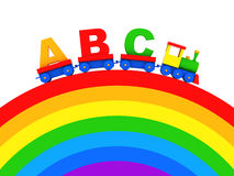 Toy alphabet. ABC text in toy locomotive carriages on rainbow Royalty Free Stock Photography