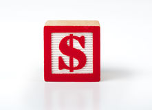 Toy Alphabet block with a dollar symbol Royalty Free Stock Image