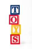 TOY alphabet blocks. Alphabet blocks stacked to spell the word TOYS on a white background vector illustration