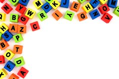 Toy alphabet letters corner border over white Royalty Free Stock Photography