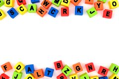 Toy alphabet letters double border over white Royalty Free Stock Photo