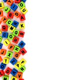 Toy alphabet letters side border over white Stock Photo