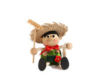 Toy Alpine inhabitant. Wooden figure of the little man in clothes of the Alpine inhabitant Stock Photo