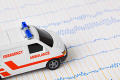 Toy ambulance car on ecg Stock Photos