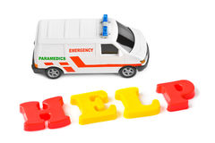 Toy ambulance car and word help Stock Photo