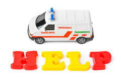 Toy ambulance car and word help Royalty Free Stock Photography