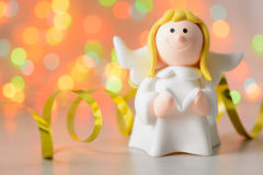 Toy angel with book in hand Stock Photos