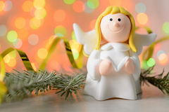 Toy angel with book in hand Royalty Free Stock Photo