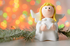 Toy angel with book in hand Royalty Free Stock Photos