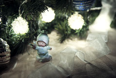 Toy angel under Christmas tree. Christmas background: little angel with presents under Christmas tree Royalty Free Stock Image