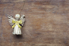 Toy angel on wood Stock Photography