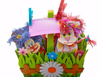 Toy animal decorative note on clothespins rope. Paper piece of writing, for the reminder. Two toy lion in a decorative basket of summer-type on a white Stock Photos