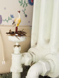 Toy animal stork in his nest inside the house Stock Photography