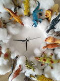 Toy animals and clocks Royalty Free Stock Image