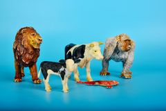 Toy animals made of plastic on a blue background, baby little animals.  royalty free stock images
