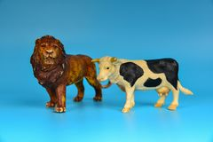 Toy animals made of plastic on a blue background, baby little animals.  stock image